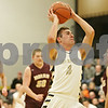 Rob Winner – rwinner@shawmedia.com<br /> <br /> Sycamore's David Compher (3) goes to basket before being called for a charging foul in the second quarter in Sycamore, Ill., Friday, Jan. 4, 2013. Morris defeated Sycamore, 41-39.