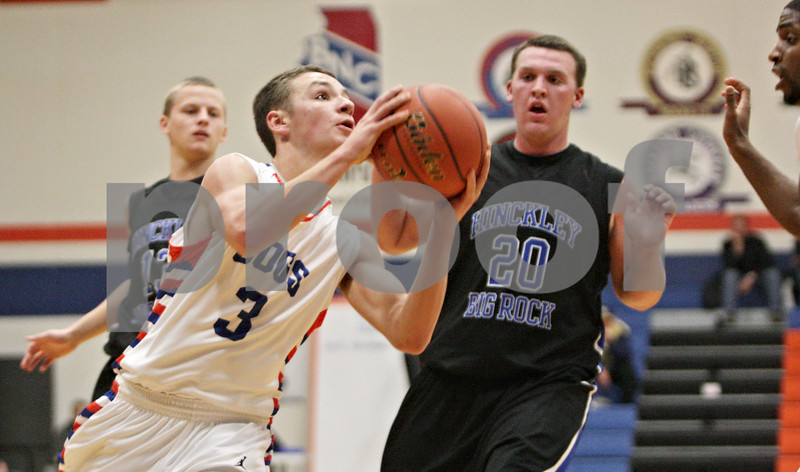 Rob Winner – rwinner@shawmedia.com<br /> <br /> Genoa-Kingston's Tommy Lucca (3) goes to the basket for two points during the second quarter in Genoa, Ill., Tuesday, Jan. 8, 2013. Hinckley-Big Rock defeated G-K, 51-40.