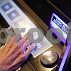 Rob Winner – rwinner@shawmedia.com<br /> <br /> Brenda Atkinson looks over the available games to play before inserting her bills into one of the video gambling machines at Karlsbad Tavern in Genoa, Ill., Wednesday, Jan. 9, 2013.