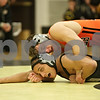 Rob Winner – rwinner@shawmedia.com<br /> <br /> DeKalb's Doug Johnson (top) controls Sycamore's Dylan Foster during their 145-pound match in Sycamore, Ill., Thursday, Jan. 10, 2013. Johnson won by technical fall.
