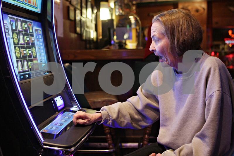 Rob Winner – rwinner@shawmedia.com<br /> <br /> Kingston resident Brenda Atkinson reacts after winning $2.50 while playing one of the three video gambling machines at Karlsbad Tavern in Genoa, Ill., Wednesday, Jan. 9, 2013.