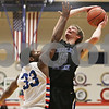 Rob Winner – rwinner@shawmedia.com<br /> <br /> Hinckley-Big Rock's Nick Gentry (15) puts up a shot good for two points over Genoa-Kingston's Gabe Williams-Torres (33) during the fourth quarter in Genoa, Ill., Tuesday, Jan. 8, 2013. H-BR defeated G-K, 51-40.