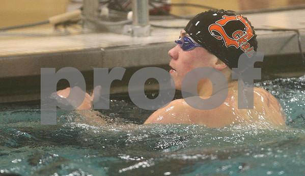 Kyle Bursaw – kbursaw@shawmedia.com<br /> <br /> DeKalb/Sycamore coop's Daniel Hein looks at his time following the 100-yard freestyle in the team's meet against Ottawa at Huntley Middle School on Monday, Jan. 7, 2013.