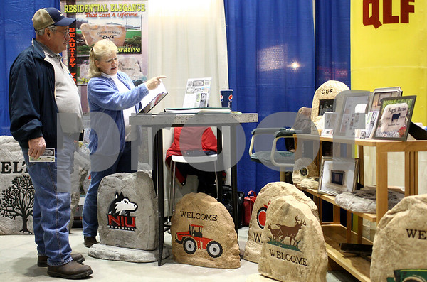 Kyle Bursaw – kbursaw@shawmedia.com<br /> <br /> Denise Maier, of Maier Precast, talks with Keith Hobson (left) about the Maier products at the Northern Illinois Farm Show at the Convocation Center on Thursday, Jan. 10, 2013.
