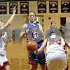 Rob Winner – rwinner@shawmedia.com<br /> <br /> Genoa-Kingston's Brea Foley (22) has the ball knocked away by Indian Creek's Josie Diehl (24) during the first quarter in Shabbona, Ill., Saturday, Jan. 5, 2013. IC defeated GK, 39-26.