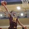 Rob Winner – rwinner@shawmedia.com<br /> <br /> Richmond-Burton's Mike Kaska (30) has his shot batted away by Genoa-Kingston's Griffin McNeal in the third quarter in Genoa, Ill., Friday, Jan. 11, 2013. Genoa-Kingston defeated Richmond-Burton, 63-50.