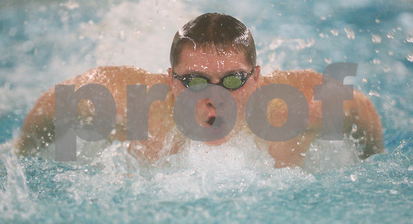 Kyle Bursaw – kbursaw@shawmedia.com<br /> <br /> DeKalb/Sycamore coop's Dylan Powers swims the 100-yard butterfly in the team's meet against Ottawa at Huntley Middle School on Monday, Jan. 7, 2013.
