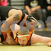 Rob Winner – rwinner@shawmedia.com<br /> <br /> Sycamore's Jake Davis (top) controls DeKalb's Leif Williams during their 195-pound match in Sycamore, Ill., Thursday, Jan. 10, 2013. Davis won by pin.