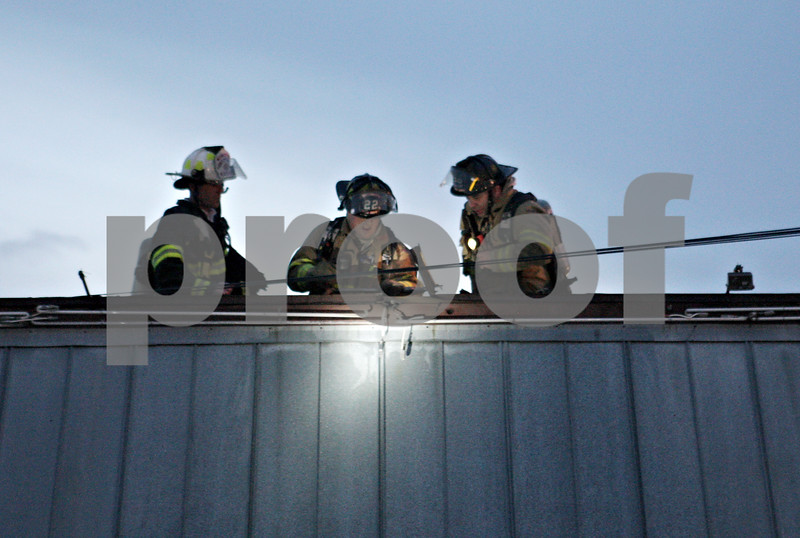 Rob Winner – rwinner@shawmedia.com<br /> <br /> Firefighters examine the roof of the Tom & Jerry's restaurant in Sycamore Friday evening.
