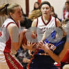 Rob Winner – rwinner@shawmedia.com<br /> <br /> Indian Creek's Josie Diehl (left) takes the ball from Genoa-Kingston's Andrea Strohmaier during the second quarter in Shabbona, Ill., Saturday, Jan. 5, 2013. IC defeated GK, 39-26.