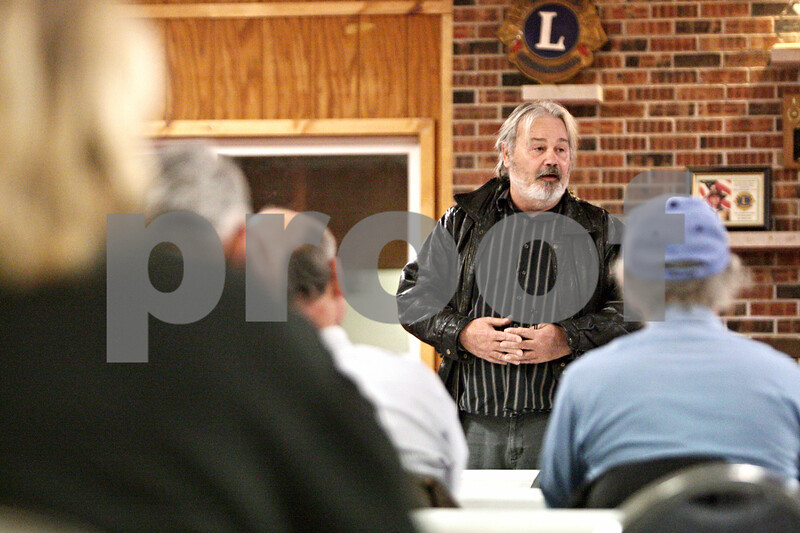 Rob Winner – rwinner@shawmedia.com<br /> <br /> Mac MacIntyre speaks to about three dozen Cortland residents during a meeting to discuss a potential lawsuit against DeKalb county to stop the proposed landfill expansion at the Cortland Lions Club building on Tuesday, Jan. 8, 2013.