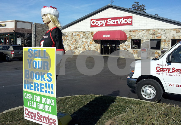 "David Thomas — dthomas@shawmedia.com<br /> <br /> Meet ""Linda"" - a mannequin-holding sign stationed outside of Copy Services. The mannequin moves its arms holding the sign, making it illegal to display the city, which has prohibited moving and rotating signs."