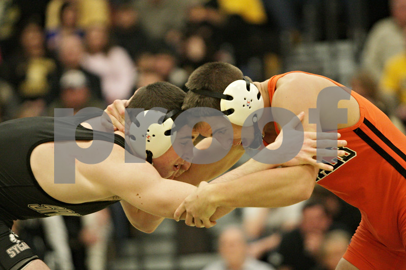 Rob Winner – rwinner@shawmedia.com<br /> <br /> Sycamore's Austin Armstrong (left) competes against DeKalb's Collin Adkins during their 160-pound match in Sycamore, Ill., Thursday, Jan. 10, 2013. Adkins won with a 3-2 decision.
