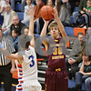 Rob Winner – rwinner@shawmedia.com<br /> <br /> Richmond-Burton's Mike Kaska puts up three points with a shot in the first quarter in Genoa, Ill., Friday, Jan. 11, 2013. Genoa-Kingston defeated R-B, 63-50.