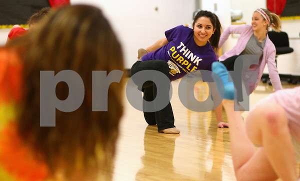 Kyle Bursaw – kbursaw@shawmedia.com<br /> <br /> Sycamore senior Alaina Stein stretches out at the start of practice for the Spartanettes on Tuesday, Jan. 8, 2013.
