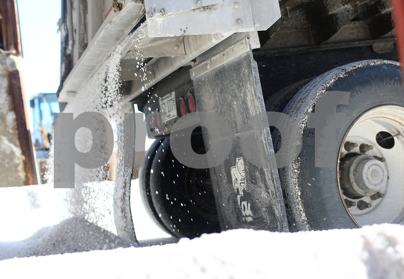 Kyle Bursaw – kbursaw@shawmedia.com<br /> <br /> A truck holding approximately 25 tons of salt prepares to unload it in front of the salt storage bin at the DeKalb streets department, the load was the first <br /> in a 350 ton order. Mark Espy, assistant director of DeKalb Public Works said it was the first order he had to place this winter after using about 350 tons of salt last weekend on the ice and snow.