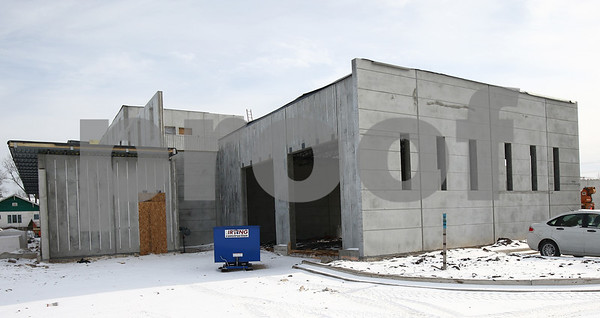 Kyle Bursaw – kbursaw@shawmedia.com<br /> <br /> The outer walls of DeKalb's new police station are up as construction continues on Monday, Jan. 14, 2013. The station is on track to open in late 2013.