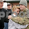 Rob Winner – rwinner@shawmedia.com<br /> <br /> Army Pfc. Craig Everhart (right) is hugged by his mother Kim and father Bob Everhart while being welcomed home by Warriors' Watch Riders and local fire and law enforcement outside the Sugar Grove Fire Department on Saturday, Jan. 12, 2013. Everhart is a 2009 Hinckley-Big Rock graduate and served nine months in Afghanistan during 2012.