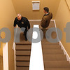 Kyle Bursaw – kbursaw@shawmedia.com<br /> <br /> Fire Chief Pete Polarek and Director of Building and Engineering John Sauter walk down the stairwell at 437 West State Street during a tour for Sycamore city officials on Monday, Jan. 7, 2013.