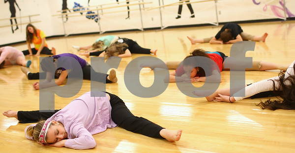 Kyle Bursaw – kbursaw@shawmedia.com<br /> <br /> Sycamore senior Emily Karsten stretches out at the start of practice for the Spartanettes on Tuesday, Jan. 8, 2013.
