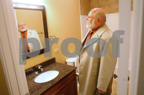 Kyle Bursaw – kbursaw@shawmedia.com<br /> <br /> Sycamore Mayor Ken Mundy checks out one of the new bathrooms at 437 West State Street during a tour for city officials in Sycamore, Ill. on Monday, Jan. 7, 2013.