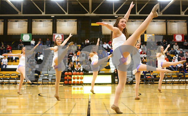 Kyle Bursaw – kbursaw@shawmedia.com<br /> <br /> Sycamore senior Taylor Kresge (center right) and her fellow Spartanettes perform a dance routine to Boyce Avenue's cover of 'Teenage Dream' at halftime of the Sycamore basketball game on Friday, Jan. 11, 2013.