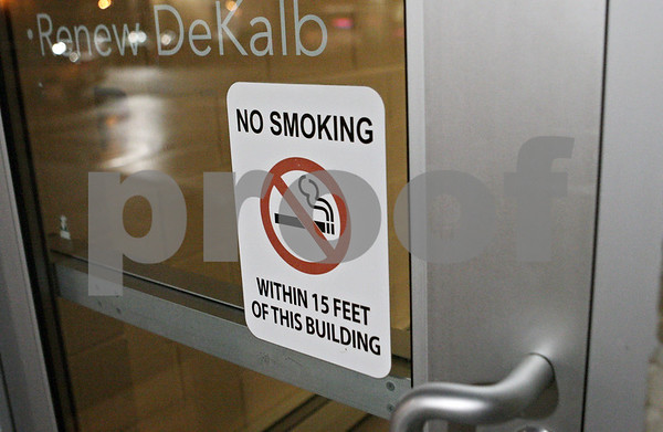 Rob Winner – rwinner@shawmedia.com<br /> <br /> A no smoking sign is seen on a door in downtown DeKalb, Ill., Friday, Jan. 11, 2013.