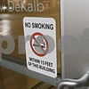 Rob Winner – rwinner@shawmedia.com<br /> <br /> A no smoking sign is seen on a door in downtown DeKalb, Ill., Friday, Jan. 11, 2013.