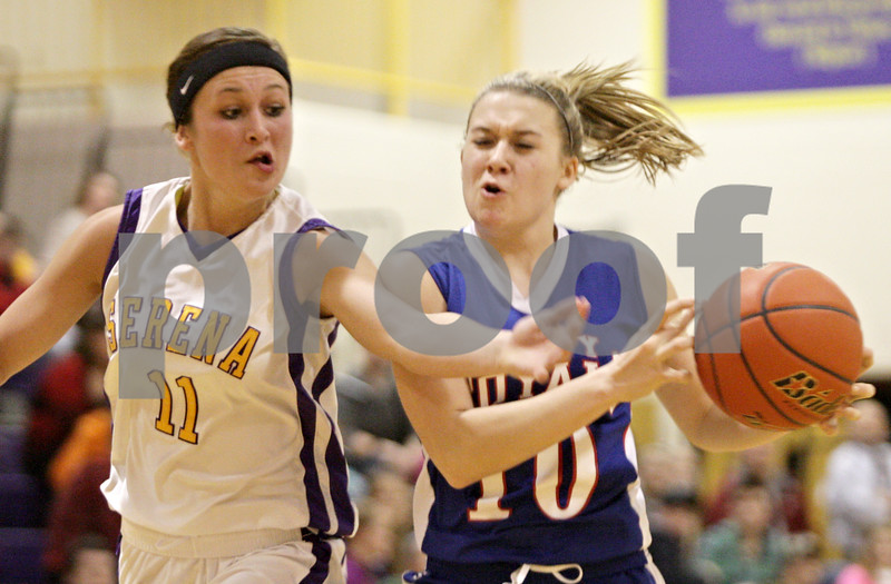 Rob Winner – rwinner@shawmedia.com<br /> <br /> Serena's Caleen Smith (11) reaches for a ball controlled by Hinckley-Big Rock's Jacqueline Madden (10) in the third quarter during the Little Ten Conference semifinal in Serena, Ill., Thursday, Jan. 17, 2013. Serena defeated H-BR, 37-35.