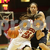 Rob Winner – rwinner@shawmedia.com<br /> <br /> Northern Illinois point guard Amanda Corral (22) drives to the basket past Akron's Hanna Luburgh during the first half in DeKalb, Ill., Wednesday, Jan. 16, 2013.