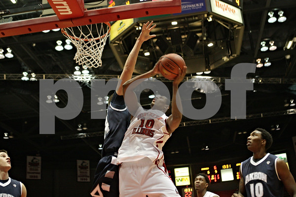 Rob Winner – rwinner@shawmedia.com<br /> <br /> Northern Illinois' Darrell Bowie (10) is fouled while shooting by Akron's Pat Forsythe (left) during the first half in DeKalb, Ill., Saturday, Jan. 12, 2013.