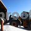 Kyle Bursaw – kbursaw@shawmedia.com<br /> <br /> Mark Pumpfrey, a crew leader and technician with DeKalb's streets department, uses a front end loader to push approximately 25 tons of salt, the first truckload in a 350 ton delivery, into their storage area. Mark Espy, assistant director of DeKalb Public Works said it was the first salt order he's placed this winter after using about 350 tons of salt last weekend on the ice and snow.