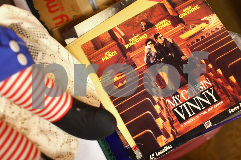 Kyle Bursaw – kbursaw@shawmedia.com<br /> <br /> A few of the many items acquired by Collectors and Modern Electronics Roadshow include a doll and this LaserDisc of 'My Cousin Vinny.' The show, held in the Best Western at 1212 Lincoln Highway will continue buying from 9 a.m. to 6 p.m. Friday and Saturday.