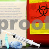 Photo Illustration by Kyle Bursaw – kbursaw@shawmedia.com<br /> <br /> An influenza vaccination and disposal container.<br /> <br /> Friday, Jan. 11, 2013.