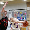 Rob Winner – rwinner@shawmedia.com<br /> <br /> Indian Creek's Kyle Lieving (left) defends as Hinckley-Big Rock's Jared Madden goes to the basket during the first quarter in Hinckley, Ill., Tuesday, Jan. 15, 2013. H-BR defeated Indian Creek, 64-60.