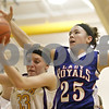 Rob Winner – rwinner@shawmedia.com<br /> <br /> Serena's Karri Stanley (33) controls a rebound ahead of Hinckley-Big Rock's Abbie Tosch (25) in the second quarter during the Little Ten Conference semifinal in Serena, Ill., Thursday, Jan. 17, 2013. Serena defeated H-BR, 37-35.