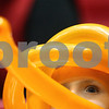 Kyle Bursaw — kbursaw@shawmedia.com<br /> <br /> DeKalb fan Briden Grainger, 6, watches the girls game between DeKalb and Sycamore beneath a few orange balloons wrapped around his head. DeKalb defeated Sycamore 36-18 in their annual game at the Convocation Center in DeKalb, Ill. on Friday, Jan. 25, 2013.