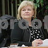 Rob Winner – rwinner@shawmedia.com<br /> <br /> DeKalb Park District President Joan Berkes-Hanson listens to Bill Ryder, the park district's athletic director, during a recent park board meeting at Hopkins Park in DeKalb, Ill.<br /> <br /> Wednesday, Jan. 16, 2013