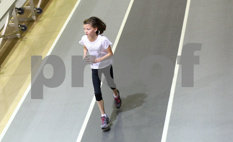 Kyle Bursaw – kbursaw@shawmedia.com<br /> <br /> Janae Heegaard, 9, runs around the track at the Chick Evans Field House during practice for the Northern Illinois Athletics track team in DeKalb, Ill. on Wednesday, Jan. 9, 2013. Doctors found a Wilms' tumor in Janae's kidney when she was five years old. As a result of the chemotherapy, one of Janae's kidneys was removed and she also developed neuropathy, which led to some stunted growth in her legs and Achilles tendon. Her parents were told that Janae would recover about 90 to 95% but would probably not be able to play on a competitive level in sports that required heavy use of the legs.