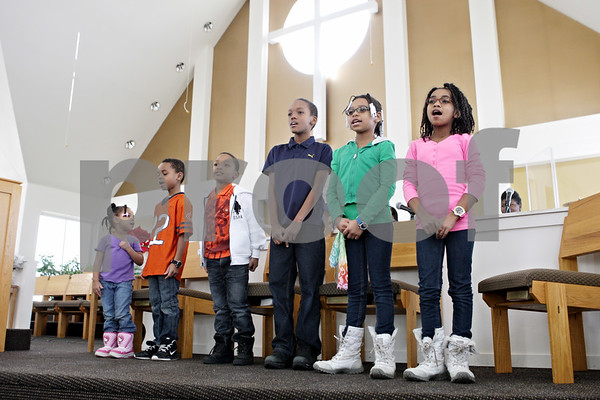 Rob Winner – rwinner@shawmedia.com<br /> <br /> Youth choir members sing during a practice at New Hope Missionary Baptist Church in DeKalb, Ill., Saturday, Jan. 19, 2013. The group will perform during a Martin Luther King Jr. Day celebration at the church on Monday evening.