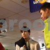 Kyle Bursaw – kbursaw@shawmedia.com<br /> <br /> Sycamore bowling coach Aaron Williams (left) talks logistics of the trip to state with Kyle Bonnell (center) and Brendan Fank while they wait to get a lane at 4 Seasons Sports on Tuesday, Jan. 22, 2013. Bonnell was the only Sycamore bowler to qualify for state, but Fank will go along on the trip.