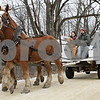 Rob Winner – rwinner@shawmedia.com<br /> <br /> On Saturday, visitors to Genoa's WinterFest at the Russell Woods Forest Preserve ride in wagon being drawn by two Belgian Draft horses owned by the Nielsen family of Waterman, including twins Sarah Nielsen (left) and Matt Nielsen.