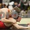 Rob Winner – rwinner@shawmedia.com<br /> <br /> DeKalb's Doug Johnson (top) controls Yorkville's Gabe Polhill in a 132-pound match during the Northern Illinois Big 12 Conference Tournament in Sycamore, Ill., Saturday, Jan. 19, 2013. Johnson won by technical fall.
