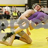Rob Winner – rwinner@shawmedia.com<br /> <br /> Kanland's Connor Williams (left) lifts Rochelle's Jacob Seldal in a 120-pound match during the Northern Illinois Big 12 Conference Tournament in Sycamore, Ill., Saturday, Jan. 19, 2013.