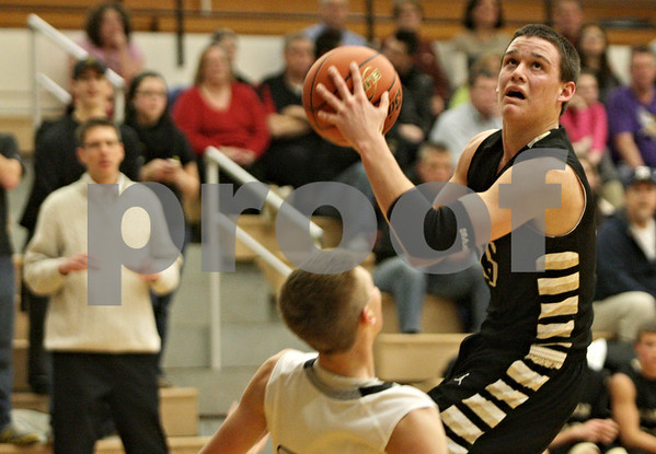 Rob Winner – rwinner@shawmedia.com<br /> <br /> Sycamore's Devin Mottet (right) is called for a charging foul after colliding with Kaneland's Dan Miller during the fourth quarter in Maple Park, Ill., Tuesday, Jan. 22, 2013. Kaneland defeated Sycamore, 43-42.