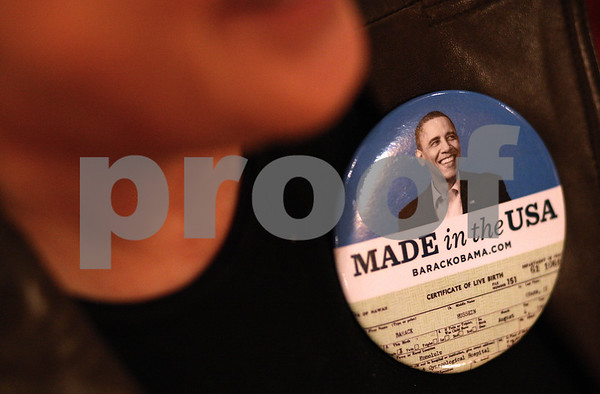Kyle Bursaw – kbursaw@shawmedia.com<br /> <br /> Misty Haji-Sheikh sports a button showing a portion of Barack Obama's birth certificate at the DeKalb County Democrats celebration at Cabana Charley's Tiki Bar & Grill in Sycamore, Ill. on Monday, Jan. 21, 2013.