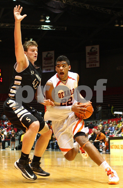 Kyle Bursaw — kbursaw@shawmedia.com<br /> <br /> DeKalb's Andre Harris drive to the basket while being defended by Sycamore's Scott Nelson in the second quarter. DeKalb and Sycamore faced off in their annual game at the Convocation Center in DeKalb, Ill. on Friday, Jan. 25, 2013.