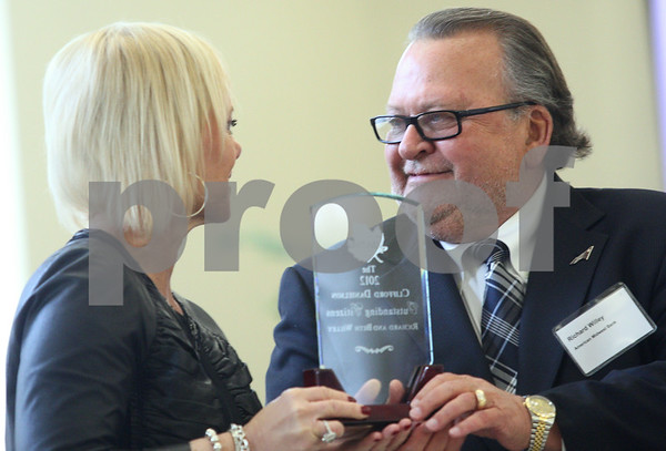 Kyle Bursaw – kbursaw@shawmedia.com<br /> <br /> Beth and Richard Willey, recipients of the Clifford Danielson Outstanding Citizen Award exchange a glance before  each making a speech at the Sycamore Chamber of Commerce's 98th annual meeting on Thursday, Jan. 24, 2013.
