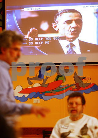 Kyle Bursaw – kbursaw@shawmedia.com<br /> <br /> A replay of Obama being sworn in plays in the background of the DeKalb County Democrat's celebration at Cabana Charley's Tiki Bar & Grill in Sycamore, Ill. on Monday, Jan. 21, 2013.