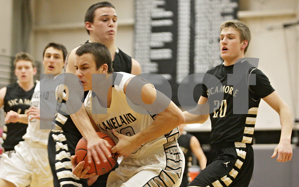 Rob Winner – rwinner@shawmedia.com<br /> <br /> Kaneland's Tyler Carlson (front) is fouled by Sycamore's Devin Mottet during the first quarter in Maple Park, Ill., Tuesday, Jan. 22, 2013. Kaneland defeated Sycamore, 43-42.